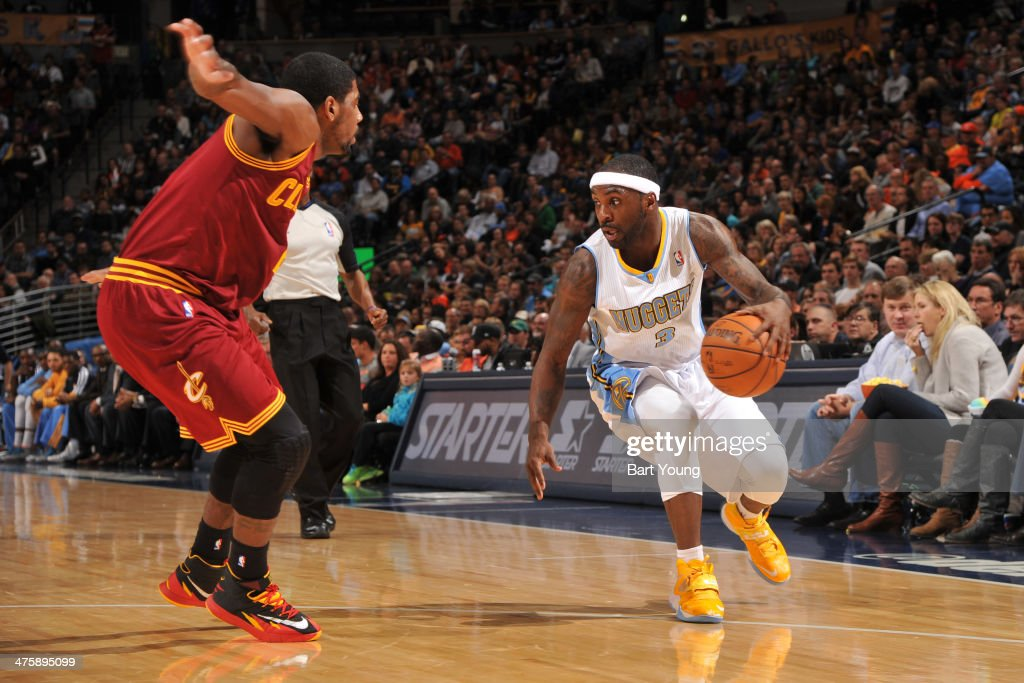 <a gi-track='captionPersonalityLinkClicked' href=/galleries/search?phrase=Ty+Lawson&family=editorial&specificpeople=4024882 ng-click='$event.stopPropagation()'>Ty Lawson</a> #3 of the Denver Nuggets handles the ball against the Cleveland Cavaliers on January 17, 2014 at the Pepsi Center in Denver, Colorado.