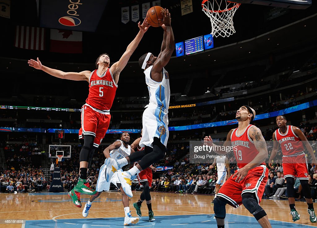 <a gi-track='captionPersonalityLinkClicked' href=/galleries/search?phrase=Ty+Lawson&family=editorial&specificpeople=4024882 ng-click='$event.stopPropagation()'>Ty Lawson</a> #3 of the Denver Nuggets has his shot blocked by <a gi-track='captionPersonalityLinkClicked' href=/galleries/search?phrase=Michael+Carter-Williams&family=editorial&specificpeople=7621167 ng-click='$event.stopPropagation()'>Michael Carter-Williams</a> #5 of the Milwaukee Bucks at Pepsi Center on March 3, 2015 in Denver, Colorado.