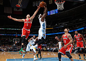 Ty Lawson of the Denver Nuggets has his shot blocked by Michael CarterWilliams of the Milwaukee Bucks at Pepsi Center on March 3 2015 in Denver...