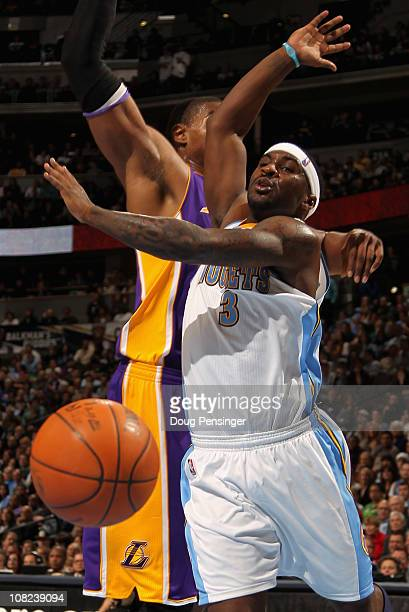 Ty Lawson of the Denver Nuggets is fouled by Andrew Bynum of the Los Angeles Lakers at the Pepsi Center on January 21 2011 in Denver Colorado The...