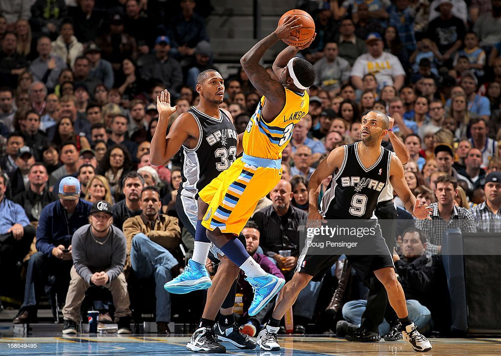 <a gi-track='captionPersonalityLinkClicked' href=/galleries/search?phrase=Ty+Lawson&family=editorial&specificpeople=4024882 ng-click='$event.stopPropagation()'>Ty Lawson</a> #3 of the Denver Nuggets is fouled by <a gi-track='captionPersonalityLinkClicked' href=/galleries/search?phrase=Boris+Diaw&family=editorial&specificpeople=201505 ng-click='$event.stopPropagation()'>Boris Diaw</a> #33 of the San Antonio Spurs as Tony Parker #9 of the San Antonio Spurs follows the play at the Pepsi Center on December 18, 2012 in Denver, Colorado. The Nuggets defeated the Spurs 112-106.