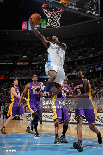 Ty Lawson of the Denver Nuggets lays in a shot against Devin Ebanks Kobe Bryant Andrew Bynum and Pau Gasol of the Los Angeles Lakers in Game Three of...