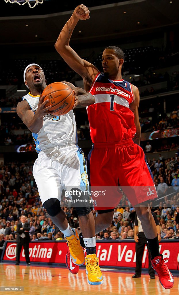 <a gi-track='captionPersonalityLinkClicked' href=/galleries/search?phrase=Ty+Lawson&family=editorial&specificpeople=4024882 ng-click='$event.stopPropagation()'>Ty Lawson</a> #3 of the Denver Nuggets lays up a shot against <a gi-track='captionPersonalityLinkClicked' href=/galleries/search?phrase=Trevor+Ariza&family=editorial&specificpeople=201708 ng-click='$event.stopPropagation()'>Trevor Ariza</a> #1 of the Washington Wizards at the Pepsi Center on January 18, 2013 in Denver, Colorado. The Wizards defeated the Nuggets 112-108.