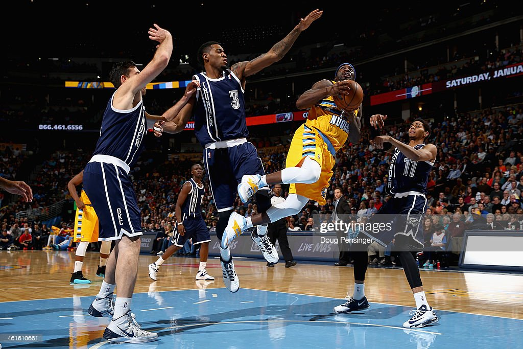 Ty Lawson of the Denver Nuggets lays up a shot and is fouled by Perry Jones of the Oklahoma City Thunder as Nick Collison and Jeremy Lamb of the...