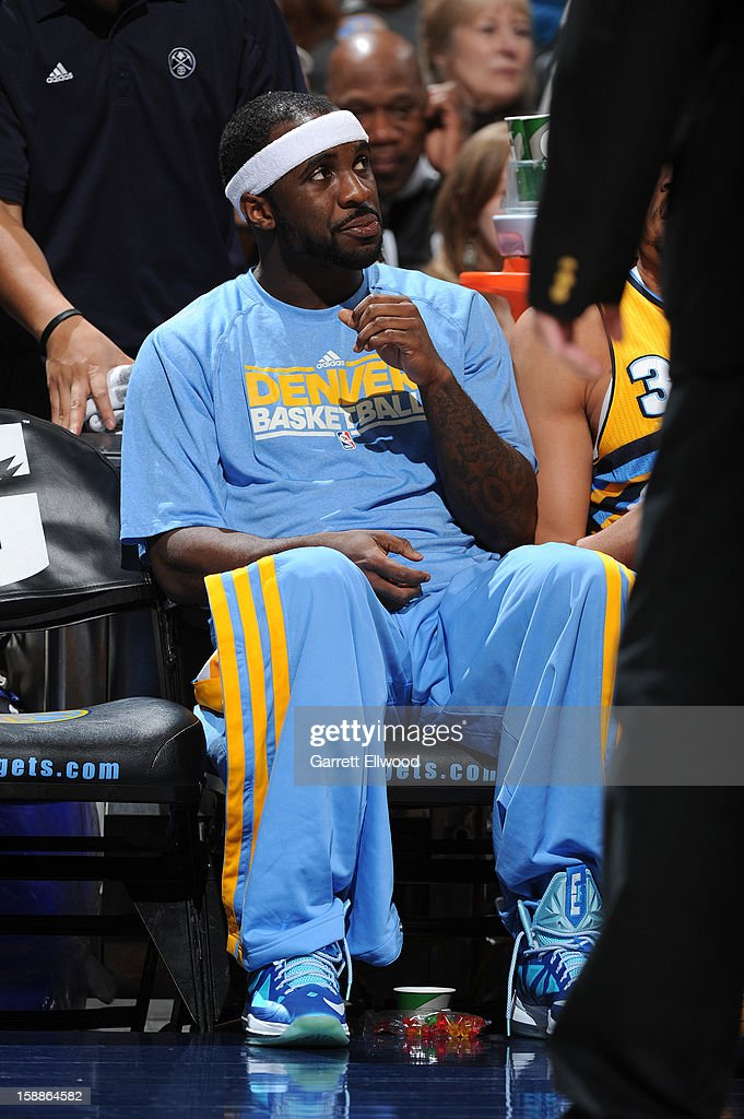 Ty Lawson #3 of the Denver Nuggets looks on from the bench during the game between the Los Angeles Clippers and the Denver Nuggets on January 1, 2013 at the Pepsi Center in Denver, Colorado.