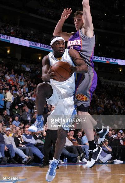 Ty Lawson of the Denver Nuggets looks to pass against the Phoenix Suns on February 3 2010 at the Pepsi Center in Denver Colorado NOTE TO USER User...