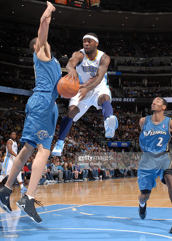 <a gi-track='captionPersonalityLinkClicked' href=/galleries/search?phrase=Ty+Lawson&family=editorial&specificpeople=4024882 ng-click='$event.stopPropagation()'>Ty Lawson</a> #3 of the Denver Nuggets looks to pass against the Washington Wizards on March 25, 2011 at the Pepsi Center in Denver, Colorado.