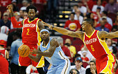 Ty Lawson of the Denver Nuggets looks to pass between Patrick Beverley and Terrence Jones of the Houston Rockets during their game at the Toyota...