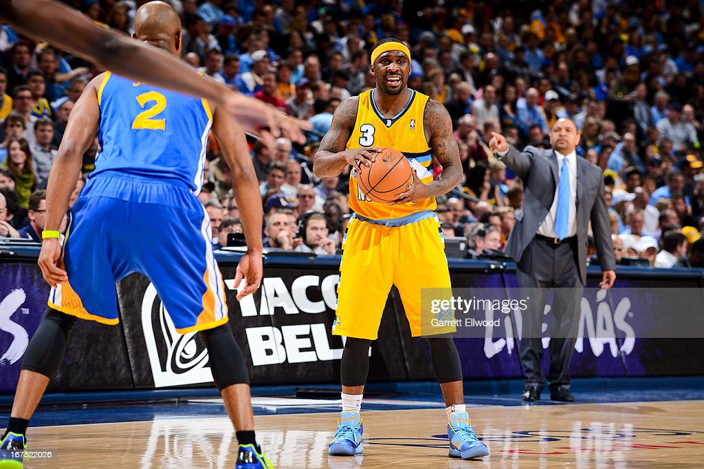 <a gi-track='captionPersonalityLinkClicked' href=/galleries/search?phrase=Ty+Lawson&family=editorial&specificpeople=4024882 ng-click='$event.stopPropagation()'>Ty Lawson</a> #3 of the Denver Nuggets looks to pass the ball against <a gi-track='captionPersonalityLinkClicked' href=/galleries/search?phrase=Jarrett+Jack&family=editorial&specificpeople=208109 ng-click='$event.stopPropagation()'>Jarrett Jack</a> #2 of the Golden State Warriors in Game Two of the Western Conference Quarterfinals during the 2013 NBA Playoffs on April 23, 2013 at the Pepsi Center in Denver, Colorado.