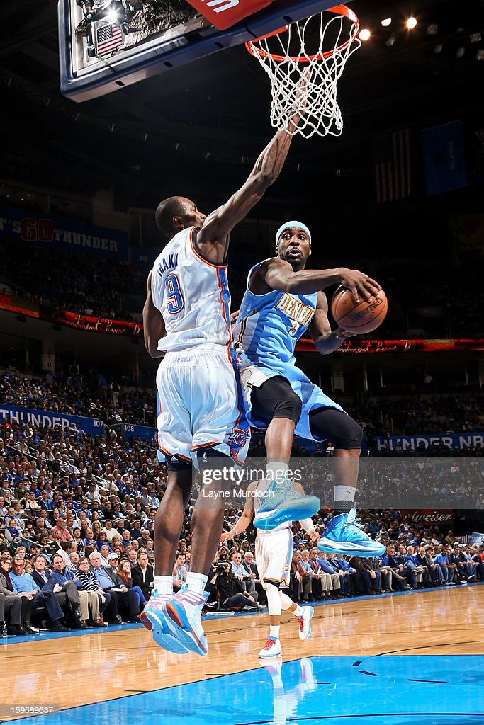 Ty Lawson #3 of the Denver Nuggets looks to pass the ball against Serge Ibaka #9 of the Oklahoma City Thunder on January 16, 2013 at the Chesapeake Energy Arena in Oklahoma City, Oklahoma.