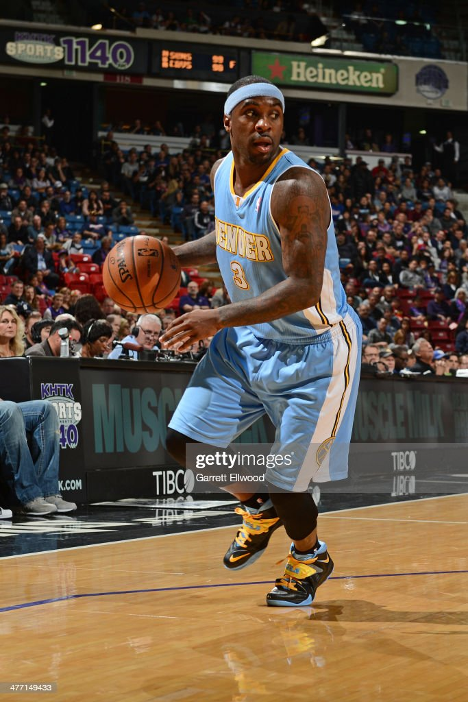 <a gi-track='captionPersonalityLinkClicked' href=/galleries/search?phrase=Ty+Lawson&family=editorial&specificpeople=4024882 ng-click='$event.stopPropagation()'>Ty Lawson</a> #3 of the Denver Nuggets looks to pass the ball against the Sacramento Kings at Sleep Train Arena on January 26, 2014 in Sacramento, California.
