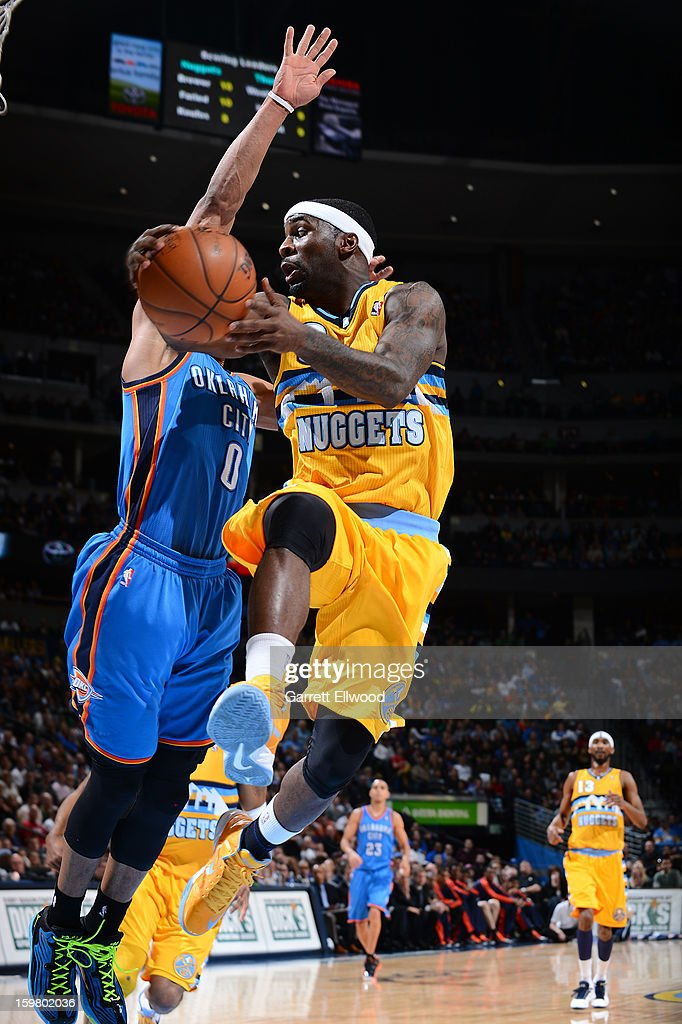 Ty Lawson #3 of the Denver Nuggets makes a move around Russell Westbrook #0 of the Oklahoma City Thunder on January 20, 2013 at the Pepsi Center in Denver, Colorado.