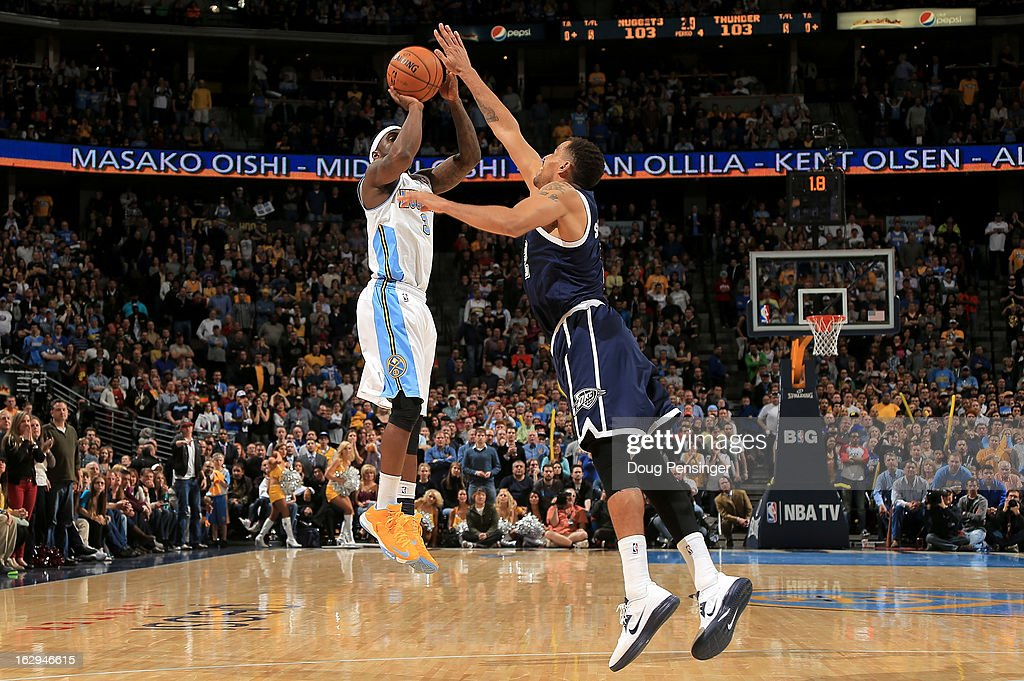 <a gi-track='captionPersonalityLinkClicked' href=/galleries/search?phrase=Ty+Lawson&family=editorial&specificpeople=4024882 ng-click='$event.stopPropagation()'>Ty Lawson</a> #3 of the Denver Nuggets makes the game winning shot over <a gi-track='captionPersonalityLinkClicked' href=/galleries/search?phrase=Thabo+Sefolosha&family=editorial&specificpeople=587449 ng-click='$event.stopPropagation()'>Thabo Sefolosha</a> #2 of the Oklahoma City Thunder in the finals seconds at the Pepsi Center on March 1, 2013 in Denver, Colorado. The Nuggets defeated the Thunder 105-103.