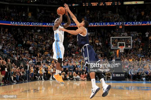 Ty Lawson of the Denver Nuggets makes the game winning shot over Thabo Sefolosha of the Oklahoma City Thunder in the finals seconds at the Pepsi...