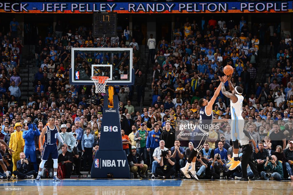 Ty Lawson of the Denver Nuggets makes the gamewinning shot against Thabo Sefolosha of the Oklahoma City Thunder on March 1 2013 at the Pepsi Center...