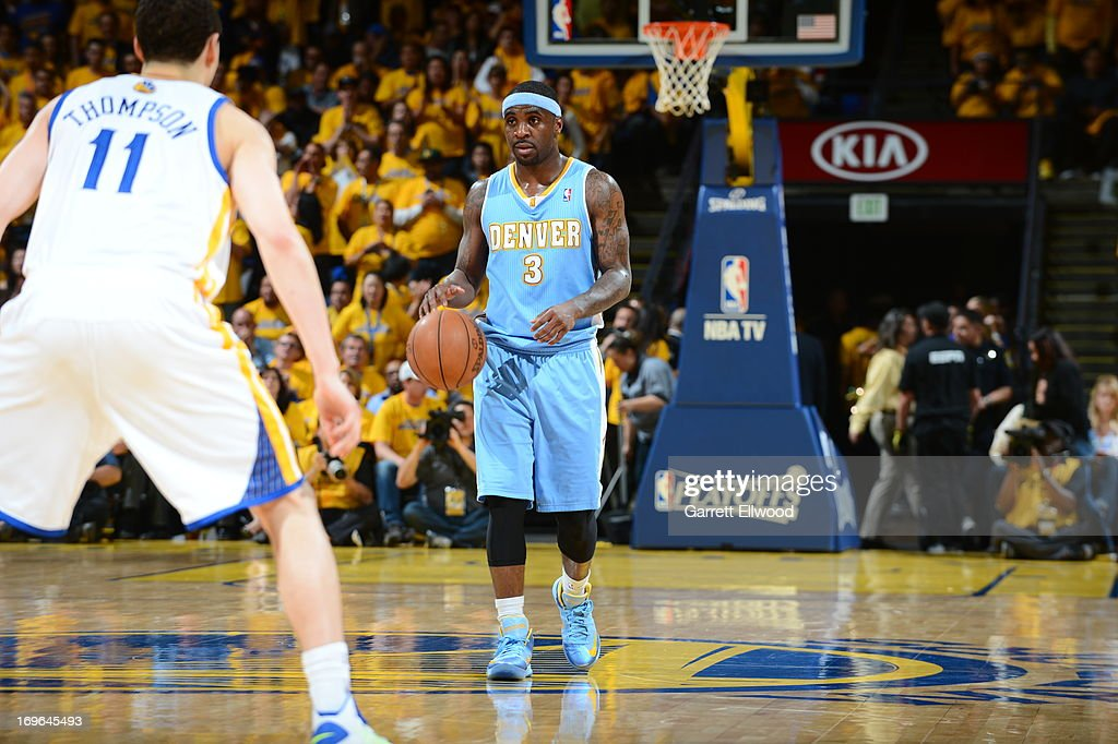 <a gi-track='captionPersonalityLinkClicked' href=/galleries/search?phrase=Ty+Lawson&family=editorial&specificpeople=4024882 ng-click='$event.stopPropagation()'>Ty Lawson</a> #3 of the Denver Nuggets moves the ball up-court against <a gi-track='captionPersonalityLinkClicked' href=/galleries/search?phrase=Klay+Thompson&family=editorial&specificpeople=5132325 ng-click='$event.stopPropagation()'>Klay Thompson</a> #11 of the Golden State Warriors in Game Three of the Western Conference Quarterfinals during the 2013 NBA Playoffs on April 26, 2013 at the Oracle Arena in Oakland, California.