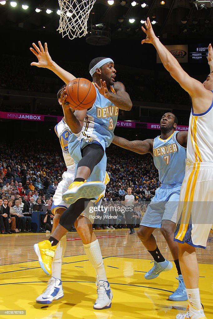 Ty Lawson #3 of the Denver Nuggets passes against the Golden State Warriors on January 15, 2014 at Oracle Arena in Oakland, California.