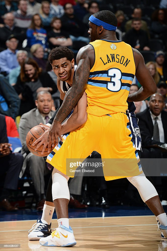 <a gi-track='captionPersonalityLinkClicked' href=/galleries/search?phrase=Ty+Lawson&family=editorial&specificpeople=4024882 ng-click='$event.stopPropagation()'>Ty Lawson</a> #3 of the Denver Nuggets playing defense during a game against the Oklahoma City Thunder on January 9, 2014 at the Pepsi Center in Denver, Colorado.