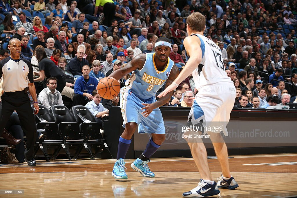 Ty Lawson #3 of the Denver Nuggets protects the ball from Luke Ridnour #13 of the Minnesota Timberwolves during the game between the Minnesota Timberwolves and the Denver Nuggets on November 21, 2012 at Target Center in Minneapolis, Minnesota.
