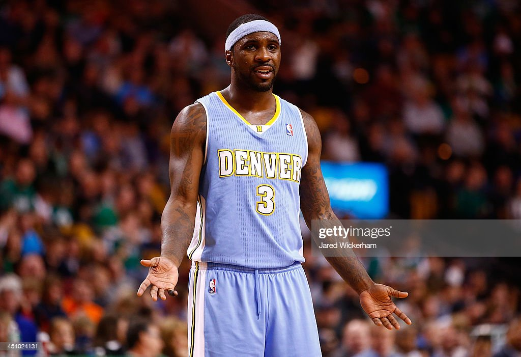 Ty Lawson of the Denver Nuggets reacts following a foul call in the second quarter against the Boston Celtics during the game at TD Garden on...