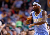 Ty Lawson of the Denver Nuggets reacts following a noncall in the second quarter against the Boston Celtics during the game at TD Garden on December...