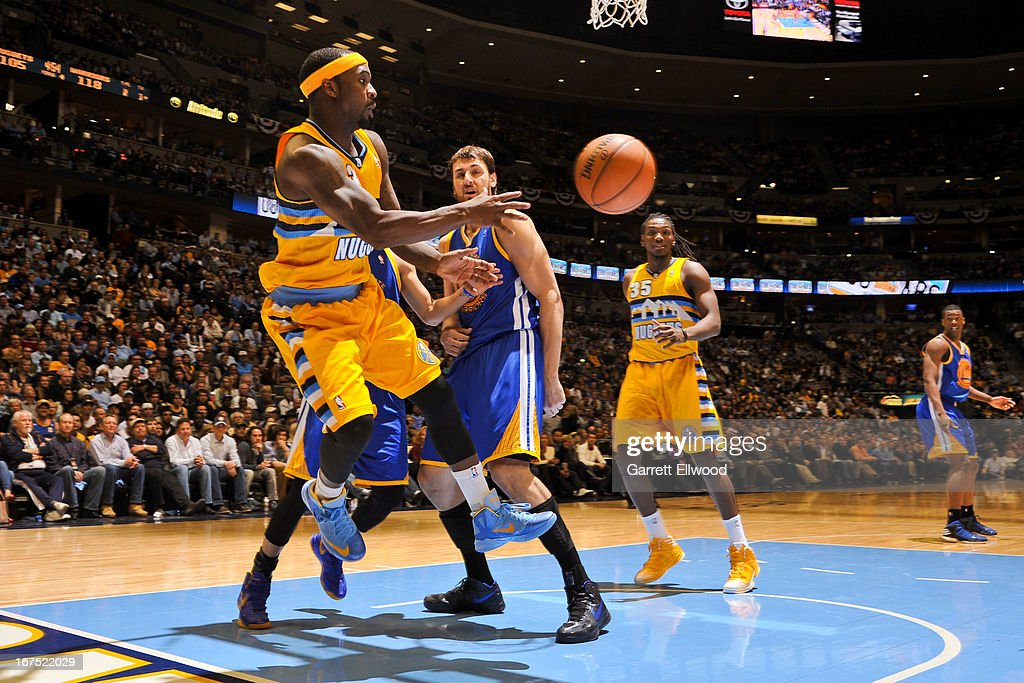 <a gi-track='captionPersonalityLinkClicked' href=/galleries/search?phrase=Ty+Lawson&family=editorial&specificpeople=4024882 ng-click='$event.stopPropagation()'>Ty Lawson</a> #3 of the Denver Nuggets saves a ball from going out-of-bounds against the Golden State Warriors in Game Two of the Western Conference Quarterfinals during the 2013 NBA Playoffs on April 23, 2013 at the Pepsi Center in Denver, Colorado.