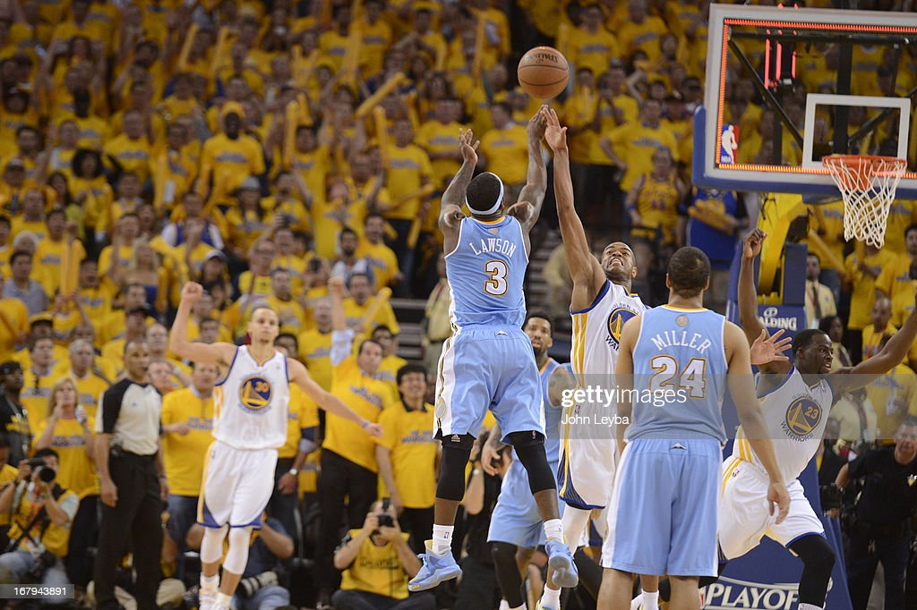 Ty Lawson (3) of the Denver Nuggets shoots a late shot with no time on the clock over Jarrett Jack (2) of the Golden State Warriors in the fourth quarter in Game 6 of the first round NBA Playoffs May 2, 2013 at Oracle Arena.