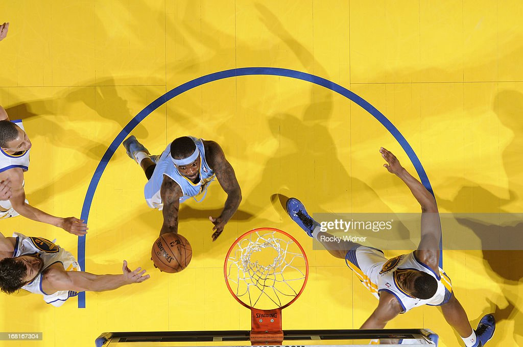 Ty Lawson #3 of the Denver Nuggets shoots a layup against Andrew Bogut #12 of the Golden State Warriors in Game Six of the Western Conference Quarterfinals during the 2013 NBA Playoffs on May 2, 2013 at Oracle Arena in Oakland, California.