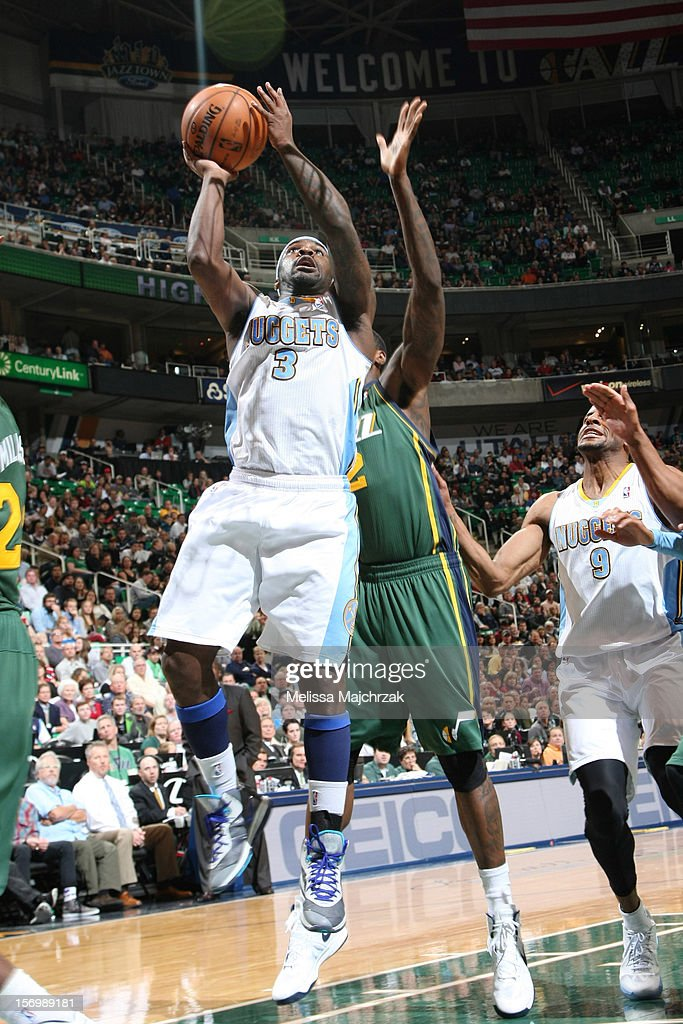 <a gi-track='captionPersonalityLinkClicked' href=/galleries/search?phrase=Ty+Lawson&family=editorial&specificpeople=4024882 ng-click='$event.stopPropagation()'>Ty Lawson</a> #3 of the Denver Nuggets shoots a layup against the Utah Jazz at Energy Solutions Arena on November 26, 2012 in Salt Lake City, Utah.