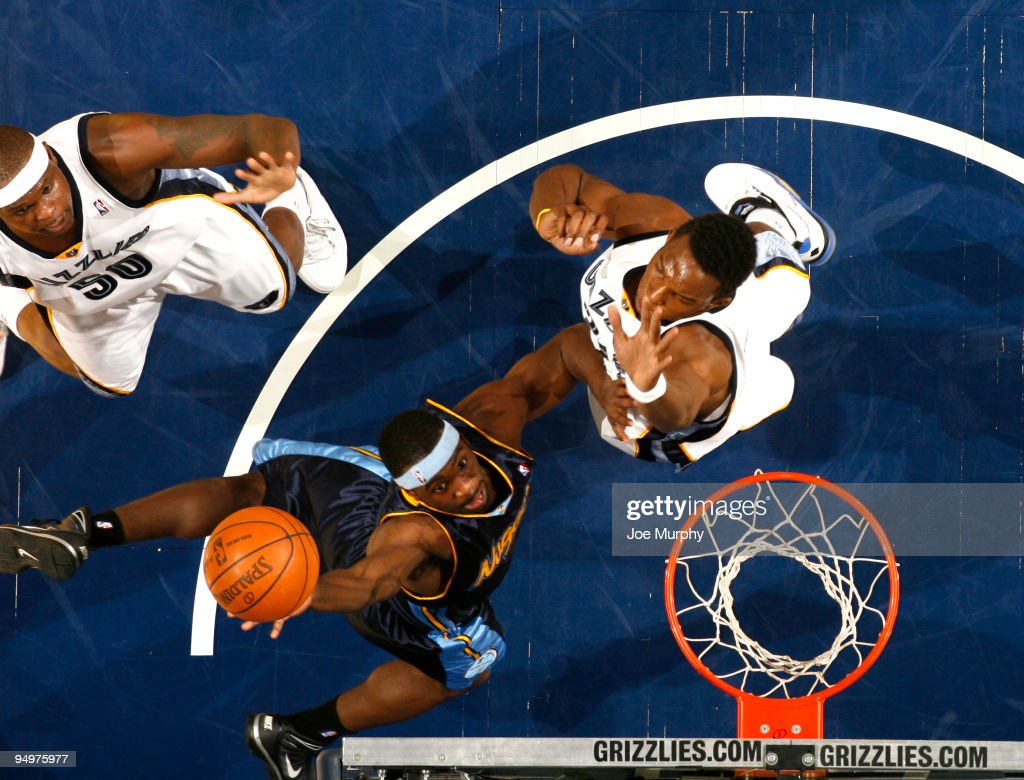 Ty Lawson of the Denver Nuggets shoots a layup over Hasheem Thabeet of the Memphis Grizzlies on December 20 2009 at FedExForum in Memphis Tennessee...