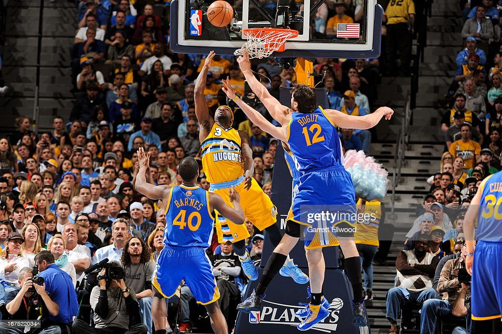 <a gi-track='captionPersonalityLinkClicked' href=/galleries/search?phrase=Ty+Lawson&family=editorial&specificpeople=4024882 ng-click='$event.stopPropagation()'>Ty Lawson</a> #3 of the Denver Nuggets shoots a reverse layup against <a gi-track='captionPersonalityLinkClicked' href=/galleries/search?phrase=Andrew+Bogut&family=editorial&specificpeople=207105 ng-click='$event.stopPropagation()'>Andrew Bogut</a> #12 and <a gi-track='captionPersonalityLinkClicked' href=/galleries/search?phrase=Harrison+Barnes&family=editorial&specificpeople=6893973 ng-click='$event.stopPropagation()'>Harrison Barnes</a> #40 of the Golden State Warriors in Game Two of the Western Conference Quarterfinals during the 2013 NBA Playoffs on April 23, 2013 at the Pepsi Center in Denver, Colorado.