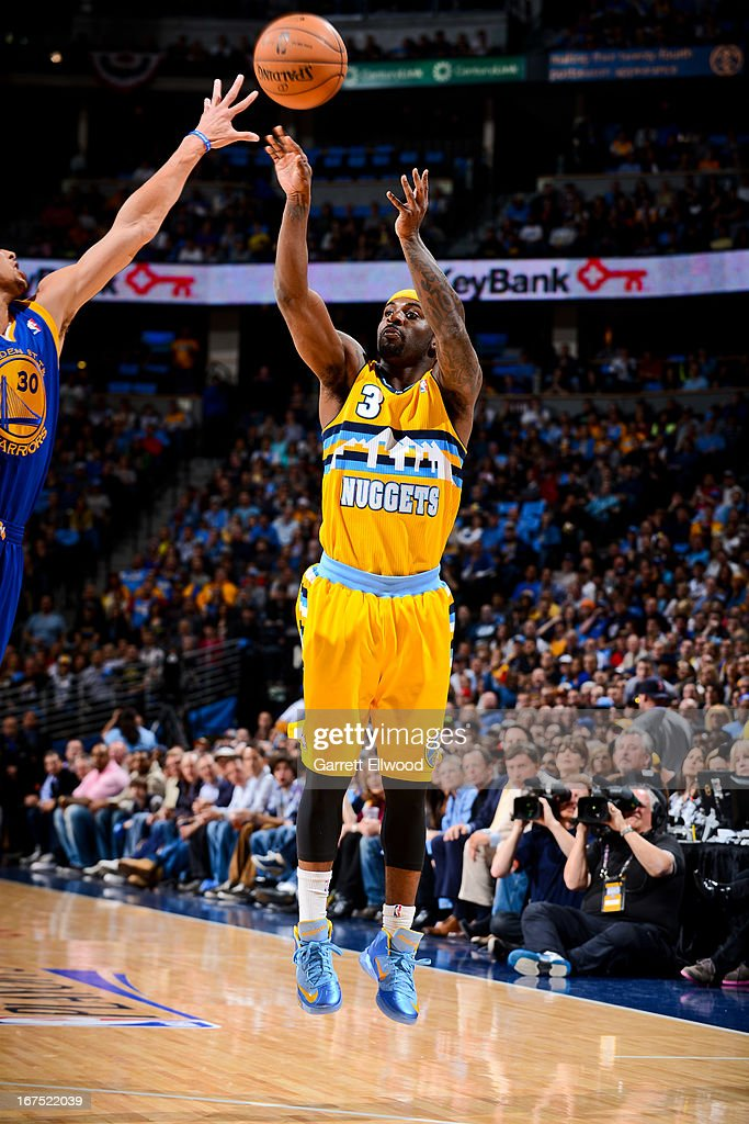 <a gi-track='captionPersonalityLinkClicked' href=/galleries/search?phrase=Ty+Lawson&family=editorial&specificpeople=4024882 ng-click='$event.stopPropagation()'>Ty Lawson</a> #3 of the Denver Nuggets shoots a three-pointer against Stephen Curry #30 of the Golden State Warriors in Game Two of the Western Conference Quarterfinals during the 2013 NBA Playoffs on April 23, 2013 at the Pepsi Center in Denver, Colorado.