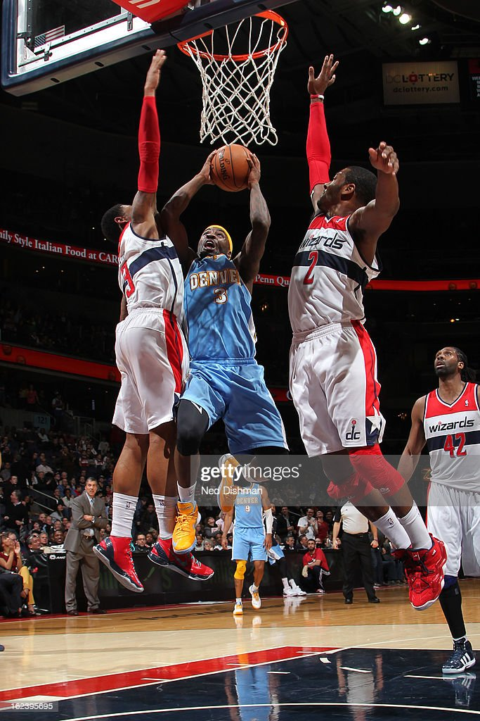 <a gi-track='captionPersonalityLinkClicked' href=/galleries/search?phrase=Ty+Lawson&family=editorial&specificpeople=4024882 ng-click='$event.stopPropagation()'>Ty Lawson</a> #3 of the Denver Nuggets shoots against <a gi-track='captionPersonalityLinkClicked' href=/galleries/search?phrase=John+Wall&family=editorial&specificpeople=2265812 ng-click='$event.stopPropagation()'>John Wall</a> #2 and <a gi-track='captionPersonalityLinkClicked' href=/galleries/search?phrase=Bradley+Beal&family=editorial&specificpeople=7640439 ng-click='$event.stopPropagation()'>Bradley Beal</a> #3 of the Washington Wizards during the game at the Verizon Center on February 22, 2013 in Washington, DC.