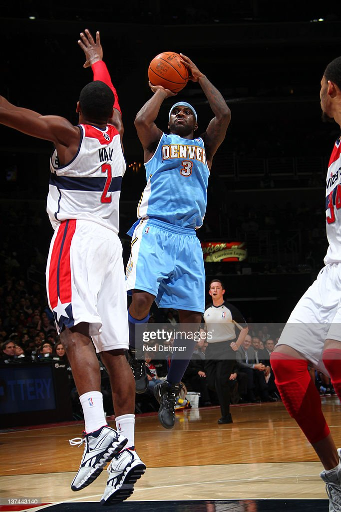 <a gi-track='captionPersonalityLinkClicked' href=/galleries/search?phrase=Ty+Lawson&family=editorial&specificpeople=4024882 ng-click='$event.stopPropagation()'>Ty Lawson</a> #3 of the Denver Nuggets shoots against <a gi-track='captionPersonalityLinkClicked' href=/galleries/search?phrase=John+Wall&family=editorial&specificpeople=2265812 ng-click='$event.stopPropagation()'>John Wall</a> #2 of the Washington Wizards during the game at the Verizon Center on January 20, 2012 in Washington, DC.