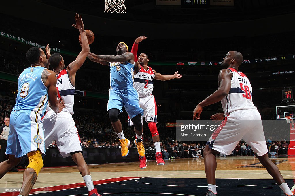 <a gi-track='captionPersonalityLinkClicked' href=/galleries/search?phrase=Ty+Lawson&family=editorial&specificpeople=4024882 ng-click='$event.stopPropagation()'>Ty Lawson</a> #3 of the Denver Nuggets shoots against <a gi-track='captionPersonalityLinkClicked' href=/galleries/search?phrase=John+Wall&family=editorial&specificpeople=2265812 ng-click='$event.stopPropagation()'>John Wall</a> #2 of the Washington Wizards during the game at the Verizon Center on February 22, 2013 in Washington, DC.
