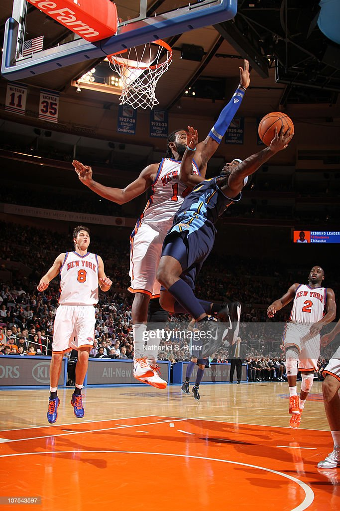 Ty Lawson of the Denver Nuggets shoots against Ronny Turiaf of the New York Knicks during a game on December 12 2010 at Madison Square Garden in New...
