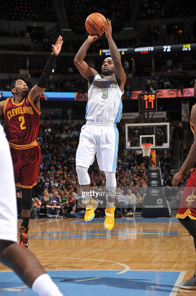 <a gi-track='captionPersonalityLinkClicked' href=/galleries/search?phrase=Ty+Lawson&family=editorial&specificpeople=4024882 ng-click='$event.stopPropagation()'>Ty Lawson</a> #3 of the Denver Nuggets shoots against the Cleveland Cavaliers on January 17, 2014 at the Pepsi Center in Denver, Colorado.