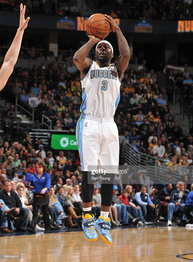 <a gi-track='captionPersonalityLinkClicked' href=/galleries/search?phrase=Ty+Lawson&family=editorial&specificpeople=4024882 ng-click='$event.stopPropagation()'>Ty Lawson</a> #3 of the Denver Nuggets shoots against the Golden State Warriors on December 23, 2013 at the Pepsi Center in Denver, Colorado.