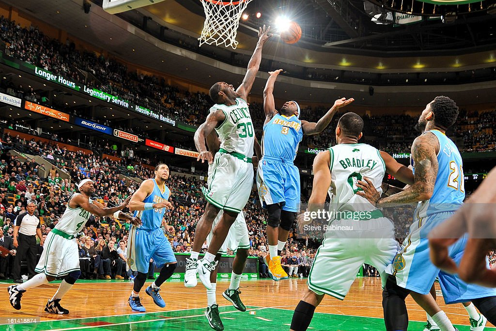 Ty Lawson #3 of the Denver Nuggets shoots in the lane against Brandon Bass #30 of the Boston Celtics on February 10, 2013 at the TD Garden in Boston, Massachusetts.