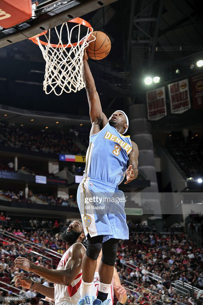 Ty Lawson #3 of the Denver Nuggets shoots the ball over James Harden #13 of the Houston Rockets on January 23, 2013 at the Toyota Center in Houston, Texas.