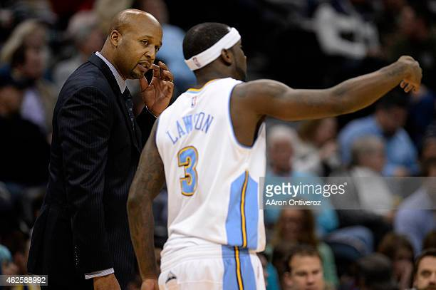 Ty Lawson of the Denver Nuggets speaks to Brian Shaw during the first quarter of action The Denver Nuggets hosted the Charlotte Hornets at the Pepsi...