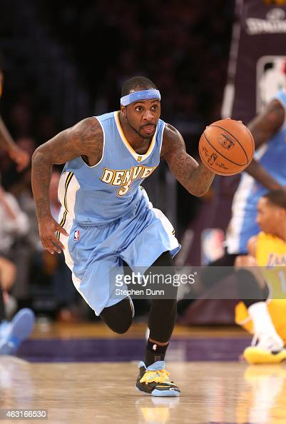 Ty Lawson of the Denver Nuggets starts a fast break against the Los Angeles Lakers at Staples Center on February 10 2015 in Los Angeles California...