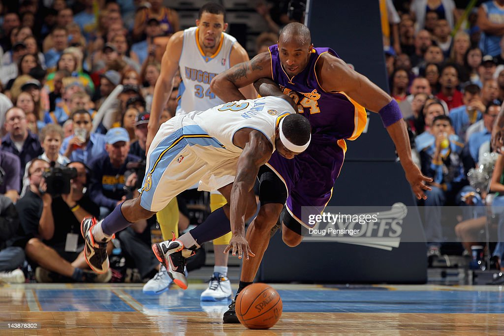 Ty Lawson of the Denver Nuggets steals the ball from Kobe Bryant of the Los Angeles Lakers and in turn is fouled by Bryant in Game Three of the...