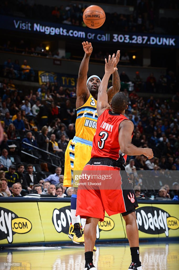 <a gi-track='captionPersonalityLinkClicked' href=/galleries/search?phrase=Ty+Lawson&family=editorial&specificpeople=4024882 ng-click='$event.stopPropagation()'>Ty Lawson</a> #3 of the Denver Nuggets takes a shot against <a gi-track='captionPersonalityLinkClicked' href=/galleries/search?phrase=Kyle+Lowry&family=editorial&specificpeople=714625 ng-click='$event.stopPropagation()'>Kyle Lowry</a> #3 of the Toronto Raptors on December 3, 2012 at the Pepsi Center in Denver, Colorado.