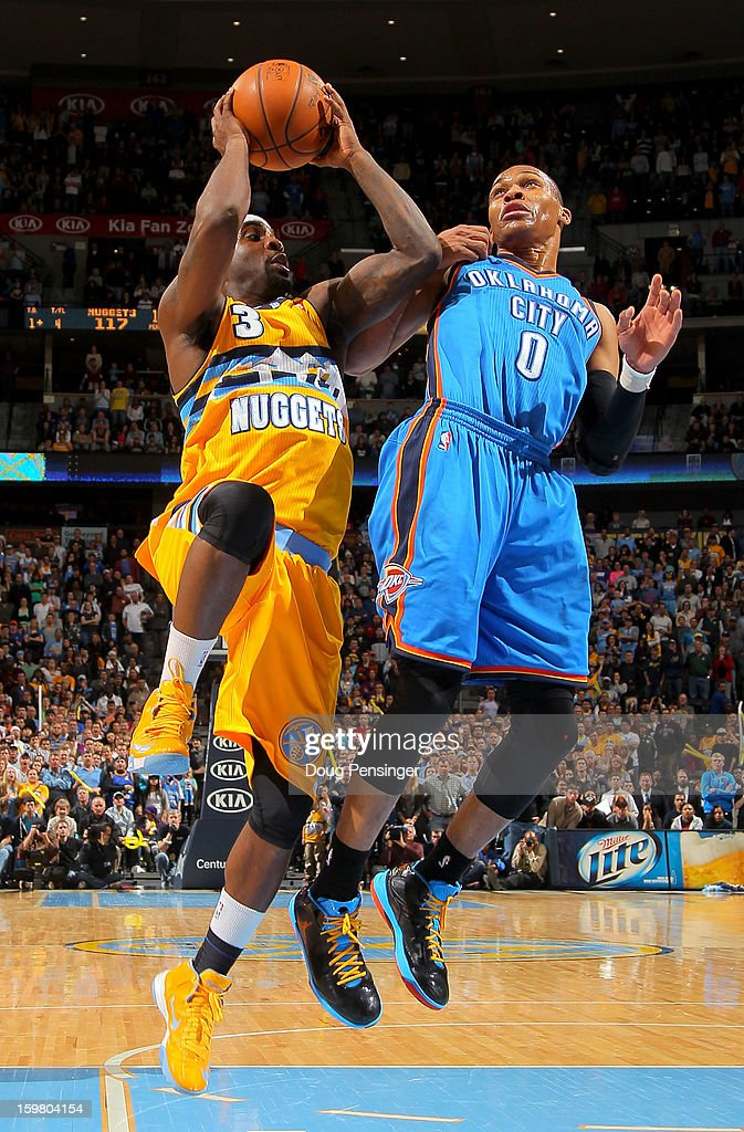 Ty Lawson #3 of the Denver Nuggets takes a shot against Russell Westbrook #0 of the Oklahoma City Thunder at the Pepsi Center on January 20, 2013 in Denver, Colorado. The Nuggets defeated the Thunder 121-118 in overtime.