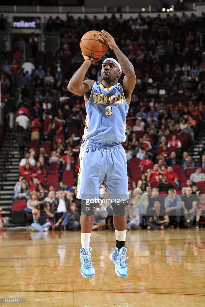 <a gi-track='captionPersonalityLinkClicked' href=/galleries/search?phrase=Ty+Lawson&family=editorial&specificpeople=4024882 ng-click='$event.stopPropagation()'>Ty Lawson</a> #3 of the Denver Nuggets takes a shot against the Houston Rockets on January 23, 2013 at the Toyota Center in Houston, Texas.