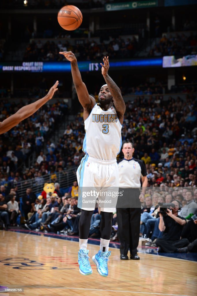 <a gi-track='captionPersonalityLinkClicked' href=/galleries/search?phrase=Ty+Lawson&family=editorial&specificpeople=4024882 ng-click='$event.stopPropagation()'>Ty Lawson</a> #3 of the Denver Nuggets takes a shot against the Los Angeles Lakers on December 26, 2012 at the Pepsi Center in Denver, Colorado.