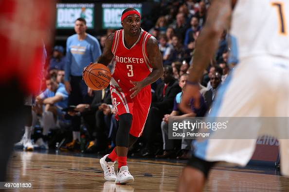 Ty Lawson of the Houston Rockets controls the ball against the Denver Nuggets at Pepsi Center on November 13 2015 in Denver Colorado The Nuggets...