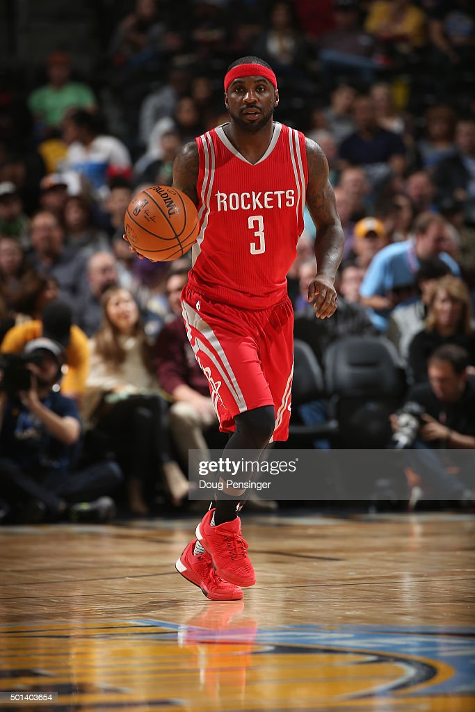 Ty Lawson of the Houston Rockets controls the ball against the Denver Nuggets at Pepsi Center on December 14 2015 in Denver Colorado The Nuggets...
