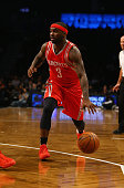 Ty Lawson of the Houston Rockets dribbles against the Brooklyn Nets during their game at the Barclays Center on December 8 2015 in the Brooklyn...